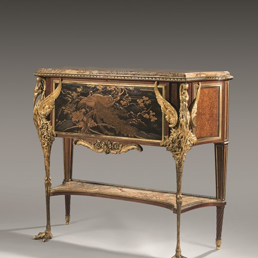 Exceptionnal ormolu-mounted, japanese lacquer and amaranth secrétaire en cabinet. A marble top above a fall front, centred by a japanese panel depicting two peacoks posed on a branch. The front upright leg supports are in the former of two Ibis depicted with deployed wings.