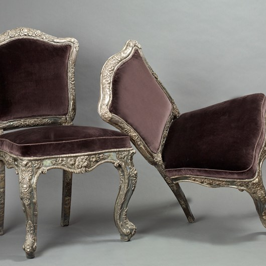 Pair of chairs once property of a Maharadjah in silver and vermillion