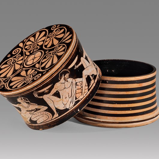 RED FIGURE PYXIS WITH EROTIC DRINKING SCENE