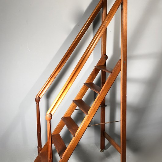 Rare Honduran mahogany library retractable staircase