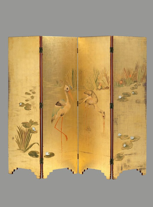 Lacquered four panel folding screen on a gold backgroud